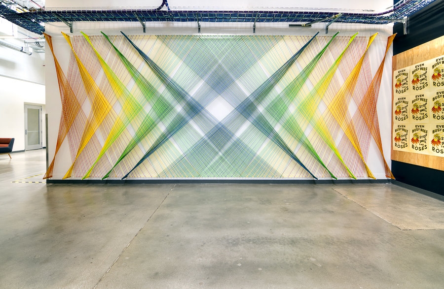 A rainbow-hued, large-scale installation at Facebook's Connectivity Lab in Northridge, California that is comprised of custom-dyed cord in six colors. By using mathematical progressions between analogous colors, Geckler creates a series of reflected chevrons that change from warm at the edges of the wall, toward cooler colors at the center of the wall.
